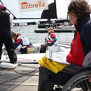 Skipper Sarah Everhart Skeels, (right), Tiverton, RI, and Cindy Walker, Middletown, RI, the only all female team competing in The Skud 18 class, prepare to leave the dock for competition during the C. Thomas Clagett, Jr. Memorial Clinic & Regatta at Newport, Rhode Island hosted by Sail Newport at Fort Adams. <br /> The Clagett is North America's premier event for sailors with disabilities with sailors competing in the 3 Paralympic class boats and is an integral part of preparation for athletes preparing for  Paralympic and world championship racing. Newport, Rhode Island, USA. 26th June 2015. Photo Tim Clayton