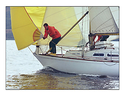 The Clyde Cruising Club's 1977 Tomatin Trophy the first Scottish Series held at Tarbert Loch Fyne.  An overnight race from Gourock to Campbeltown then on to Olympic Triangles in Loch Fyne. ..501C She She, Nick Wright's entry to the Series. Bow work and yellow wellies..