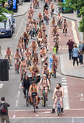 """© Licensed to London News Pictures.  <br /> 17/06/2018; Bristol, UK. The World Naked Bike Ride takes place through Bristol city centre. The event sees hundreds of naked and near naked cyclists cycle around Bristol city centre to campaign for improved cycle routes in Bristol and to raise awareness of the dangers and vulnerability cyclists in the city face on a daily basis. The event included a symbolic """"die-in"""" to commemorate the 23 cyclists that have been killed on Bristol's roads. Photo credit: Simon Chapman/LNP"""