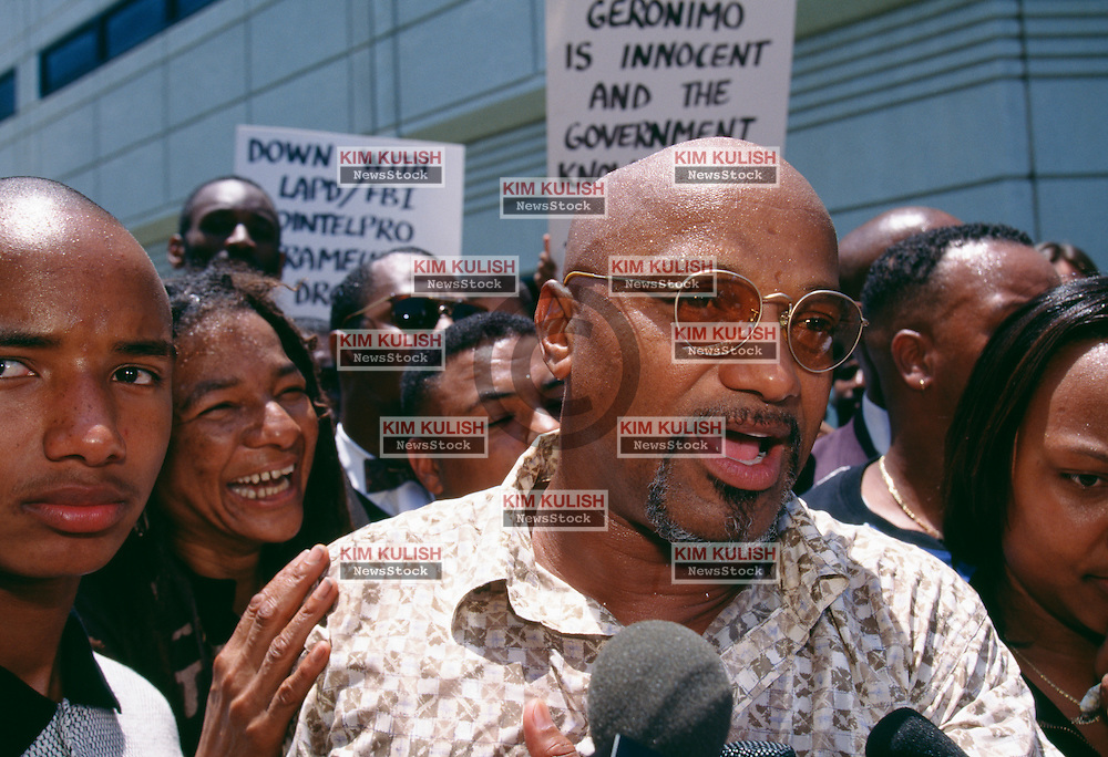 """Former Black Panther Elmer """"Geronimo"""" Pratt  makes his way though joyous supporters as he is released from jail after his murder conviction for the December 1968 murder of Santa Monica schoolteacher Caroline Olsen was overturned after serving 27 years of a life sentence."""