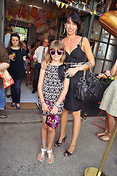 ASSIA WEBSTER and her daughter NIKA at the 10th anniversary party of the store Caramel, Ledbury Road, London W11.  The party was held in association with the Naked Heart Foundation - a charity set up by model Natalia Vodianova.