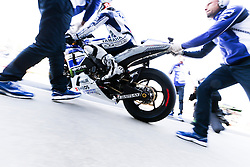 © Licensed to London News Pictures. 19/10/2012. Jorge Lorenzo (SPA) riding for the Yamaha Factory Racing gets pushed out of the pits  during the Qualifying day of the round 16 2013 Tissot Australian Moto GP at the  Phillip Island Grand Prix Circuit Victoria, Australia. Photo credit : Asanka Brendon Ratnayake/LNP