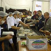 People getting their meals from the tent donated by the Eminonu Shop Owners Associtaion at the first day of Ramadan which is the holly fasting  season for the Muslims.   Saturday, 23.09.2006<br /> Photo by Ahmet DUMANLI/TURKPIX