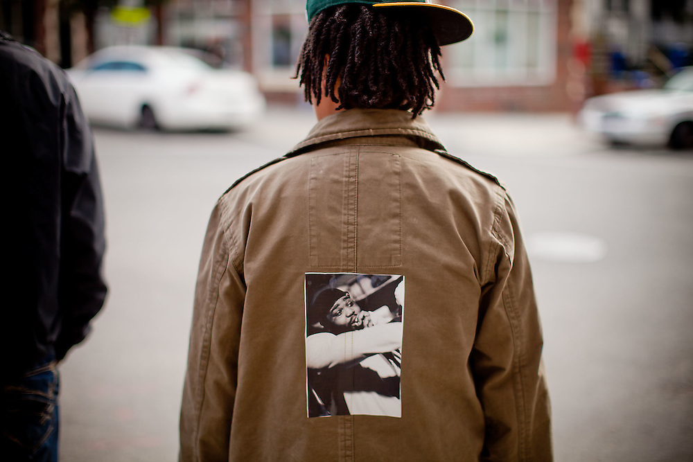 Washington, Oct. 6, 2010 - Funeral for Jamal Coates - A funeral-goer with a tribute to Jamal Coates on his coat.  (Photo by Jay Westcott/TBD)