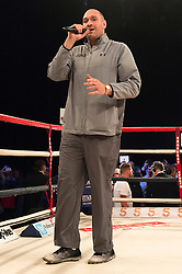 © Licensed to London News Pictures. 26/03/2016. British boxer TYSON FURY sings at  the boxing fight between NICK BLACKWELL as he defends his British middleweight championship against number one-ranked contender CHRIS EUBANK JR at the SSE Arena, Wembley.   Twenty-five-year-old Blackwell is one of the most exciting fighters in the country and won the British middleweight title in May 2015.  He has since defended his title twice.  London, UK. Photo credit: Ray Tang/LNP