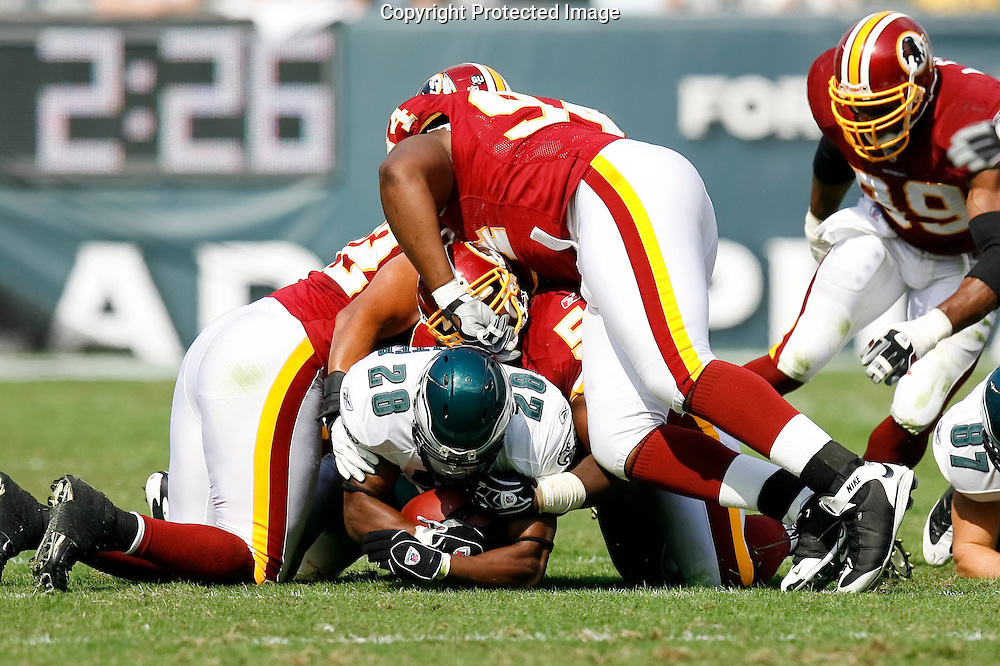 5 Oct 2008: Philadelphia Eagles running back Correll Buckhalter #28 finds himself under a few Washington Redskins during the game against the Washington Redskins on October 5th, 2008. The Redskins won 23-17 at Lincoln Financial Field in Philadelphia, Pennsylvania.