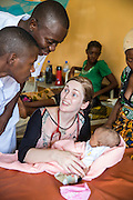 VSO volunteer Dr Siobhan Neville who specialise in paediatrics in discussion about symptoms to look out for with new born babies during a training session with local nurses Vincent Felix & Christopher Charlie. St Walburg's Hospital, Nyangao. Lindi Region, Tanzania.