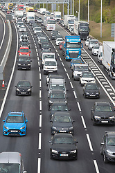 © Licensed to London News Pictures 30/04/2021. Wrotham, UK. Heavy traffic on the M20 motorway coast bound this evening near Wrotham in Kent. Motorists have been warned to expected delays on the road this May Bank holiday weekend as a total of 14 million getaway journeys are possible after a poll by the RAC. Saturday could be the busiest day on the roads in years due to coronavirus lockdown easing. Photo credit:Grant Falvey/LNP