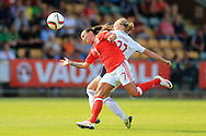 Natasha Harding of Wales is tackled by Marit Sandvei of Norway. Wales Women v Norway Women, Women's Euro 2017  Qualifying, group 8 match at the Newport Stadium in Newport, South Wales on Tuesday 7th June 2016. pic by  Andrew Orchard, Andrew Orchard sports photography.