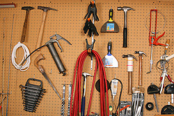 06 April 2008: tools hang indiscriminately on pegboard on the wall of the shop.