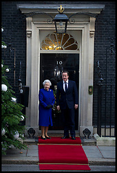 HM The Queen is greeted by The Prime Minister David Cameron as she arrive's at No10 Downing Street, London to observe the weekly Cabinet meeting, Tuesday December 18, 2012. Photo by Andrew Parsons / i-Images