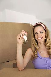 Portrait woman holding house keys new apartment