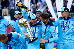 Eoin Morgan of England lifts the ICC Cricket World Cup Trophy with Jos Buttler of England their side are crowned Champions for 2019 - Mandatory by-line: Robbie Stephenson/JMP - 14/07/2019 - CRICKET - Lords - London, England - England v New Zealand - ICC Cricket World Cup 2019 - Final