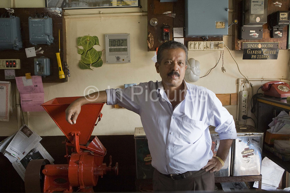 Portrait of the owner of Ganesh coffee, Madikeri. Coorg or Kadagu is the largest coffee growing region of India, in the state of Karnataka, the inhabitants - the Kodavas have been cultivating crops such as coffee, black pepper and cardamon for many generations.
