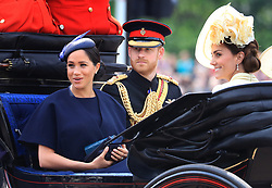 File photo dated 8/6/2019 of the Duke and Duchess of Sussex and the Duchess of Cambridge make their way along The Mall to Horse Guards Parade, in London, ahead of the Trooping the Colour ceremony. The Duke is celebrating his birthday - his first as a father.