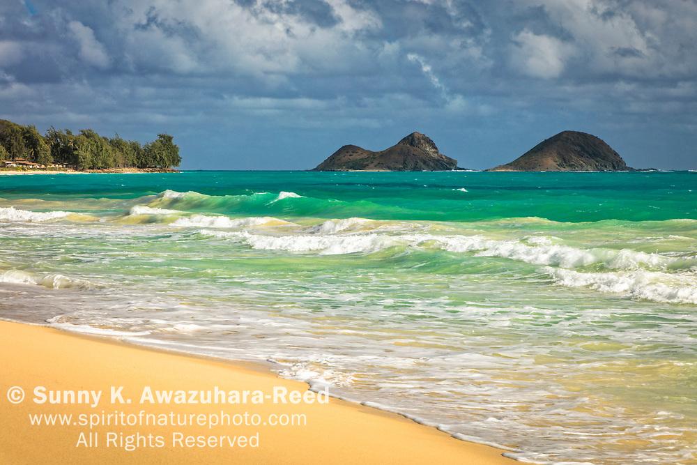 Mokulua Islands and Bellows Beach under blue sky, Oahu Island, Hawaii.