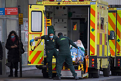 © Licensed to London News Pictures.17/01/2021, London,UK. A patient is transferred on stretcher from an ambulance at the Royal London Hospital in east London as the third national lockdown continues and hospitals are struggling to cope with the number of admissions. Photo credit: Marcin Nowak/LNP
