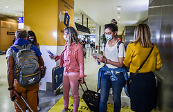 Workers at the Athens International airport give face mask and antiseptic to passenger from France that arrieved to the Eleftherios Venizelos International Airport in Athens, Monday, June 15, 2020. Greece is officially open to tourists as of Monday, with the first international flights expected into Athens and the northern city of Thessaloniki where passengers will not face compulsory COVID-19 tests. Seasonal hotels and museums are also opening across the country. <br /> <br /> Pictured: <br /> Dimitris Lampropoulos  | EEm date