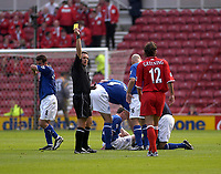 Photo. Glyn Thomas,  Digitalsport<br />Middlesbrough v Everton. Barclaycard Premiership.<br />Riverside Stadium, Middlesbrough. 21/09/2003.<br />Boro's Jonathan Greening (R) is shown the yellow card as Gary Naysmith receives treatment after the foul.