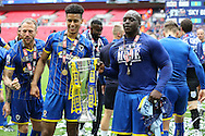 Lyle Taylor of AFC Wimbledon and Adebayo Akinfenwa of AFC Wimbledon ® pose with the Sky Bet League 2 Play-off Trophy. Skybet football league two play off final match, AFC Wimbledon v Plymouth Argyle at Wembley Stadium in London on Monday 30th May 2016.<br /> pic by John Patrick Fletcher, Andrew Orchard sports photography.