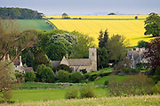Asthall Manor House, village and Church of St Nicholas in The Cotswolds, Oxfordshire, United Kingdom