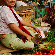Women selling goods at market at Inle region