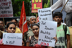 June 9, 2017 - Kolkata, West Bengal, India - Activists of Communist Party of India (Marxist–Leninist)  protest against killing of five farmers of  Mandsaur police firing incident, at Madhya Pradesh government office in Kolkata , India on Friday, 9th June , 2017. At least five farmers were killed and several injured in Mandsaur district on Tuesday when police fired on protesters demanding better prices in the drought-ravaged region that recorded a farm suicide every five hours in 2016-17. (Credit Image: © Sonali Pal Chaudhury/NurPhoto via ZUMA Press)