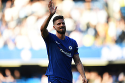 Chelsea's Olivier Giroud waves to fans at full time