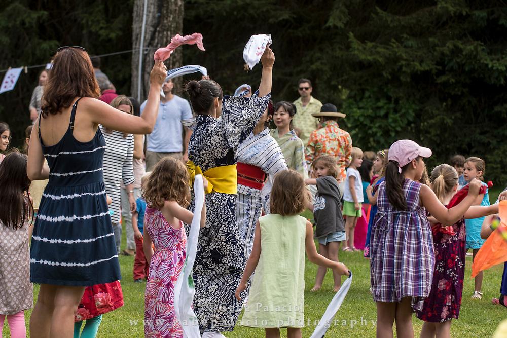 Dancing at Dusk, A Voyage to Japan, on Friends Field at Caramoor in Katonah New York on June 28, 2017. <br /> (photo by Gabe Palacio)