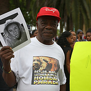 "Protesters march and hold signs in the No Justice No Peace- ""March Against Gun Violence""  walk from Lake Eola in downtown Orlando, to the Orange County Courthouse on Wednesday, July 17, 2013. The march was organized by the Modarres Law Firm and Orlando attorney Natalie Jackson, one of the attorneys for Trayvon Martins parents. (AP Photo/Alex Menendez)"