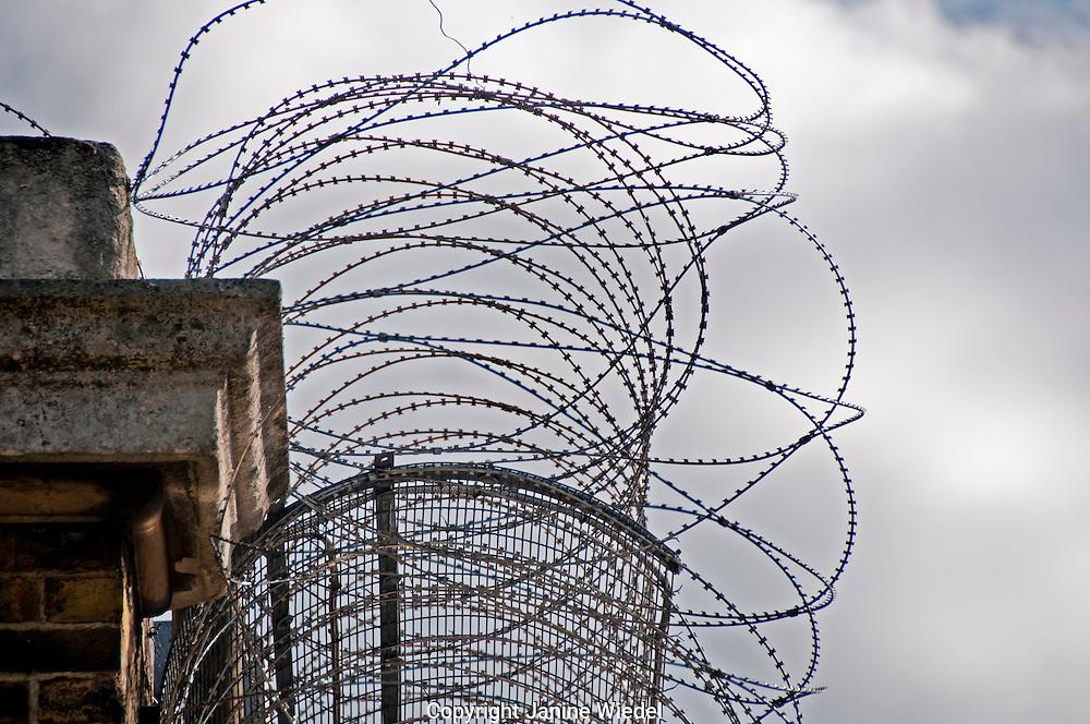 Razor wire on walls of Brixton Prison South LondonBrixton prison in South London