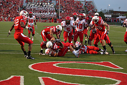 19 September 2009: Tyrone Walker struggles to remain on his feet as he backs in to the endzone pushing aside Daniel Becker in a game which the Austin Peay Governors were defeated 38-7 by the Illinois State Redbirds at Hancock Stadium on campus of Illinois State University in Normal Illinois