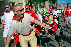 12 July 2014. New Orleans, Louisiana.<br /> The 8th annual San Fermin in Nueva Orleans, the annual Encierro (bull run) festival paying homage to the world famous Encierro of Pamplona, Spain<br /> Photo; Charlie Varley/varleypix.com