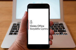 Using iPhone smartphone to display logo of the Wales Office