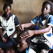 Young girls learn to become hair dressers in Bolgatanga, Ghana, a scheme set up by the local ngo Afrikids.
