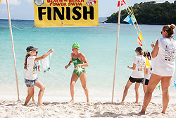 St. Croix Dolphin Natalia Kuipers, 13, is the first to cross the finish line at Hawksnest beach.  Friends of the Virgin Islands National Park hosts its 13th annual Beach to Beach Power Swim.  Beginning at Maho Bay racers had a choice of three distances and crossed the finish lines at Cinnamon Bay, Trunk Bay, and Hawksnest beCH.   finishiesRacers had a choice of finishing at © Aisha-Zakiya Boyd