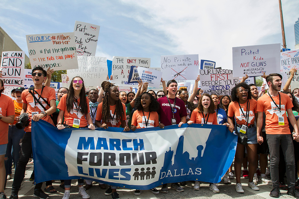Organizing students of the March for Our Lives in downtown Dallas chant in protest over the lack of security at schols across the country after the latest spate of school shootings.