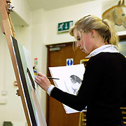 A teenage girl painting during art lesson at Ampleforth College, North Yorkshire, UK. Ampleforth College is a coeducational independent day and boarding school in the village of Ampleforth, North Yorkshire, England. It opened in 1802 as a boys' school, and is run by the Benedictine monks and lay staff of Ampleforth Abbey.