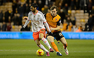 Bryan Ruiz shields the ball from Kevin McDonald during the Sky Bet Championship match between Wolverhampton Wanderers and Fulham at Molineux, Wolverhampton, England on 24 February 2015. Photo by Alan Franklin.