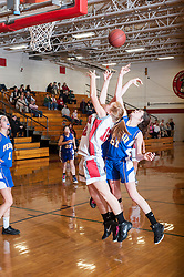 Laconia freshman Taylor Sullivan goes head to head with Franklin junior Katrina Styles for a rebound during Tuesday's match at Laconia High School.  (Alan MacRae/for the Laconia Daily Sun)