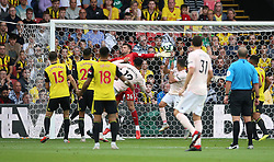 Manchester United's Chris Smalling (centre) scores his side's second goal of the game during the Premier League match at Vicarage Road, Watford