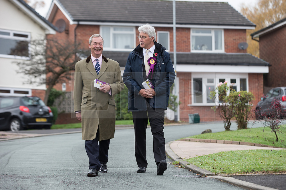 © Licensed to London News Pictures . 03/11/2015 . Oldham , UK . UKIP leader NIGEL FARAGE and candidate JOHN BICKLEY out canvassing for the seat of Oldham West and Royton , on Lindenwood , Chadderton . The by-election has been triggered by the death of MP Michael Meacher . Photo credit : Joel Goodman/LNP