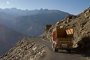 Indian truck drivers and their trucks, 22nd October 2009, Himachal Pradesh, India. The trucks drive along roads in this area that are often precarious, with vehciles seen clinging to the edge with a sheer cliff drop on the side. The region of Spiti and Kinnaur is a remote and tribal area of the Indian Himalayas near the Tibetan border.