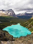 Taking in the view over beautiful, remote Lake O'Hara and Mount Odoray in Yoho National Park, near Field, British Columbia, Canada
