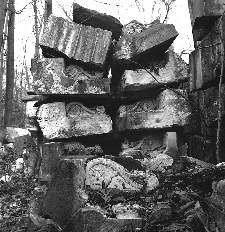 Capitol Ruins.  These photos are from a series I shot of old stones that used to be part of the United States Capitol Building. Lost in the woods, ornate stones, grown-over vessels, wind blown leaves. Once majestic, the remains of the original East Front of the U.S. Capitol now seem to lie forgotten.  These sandstones were torn away from The Capitol in 1959, during construction of an extension to the original building. The sandstone, quarried from Aquia Creek in Virginia, was replaced by the Georgia Marble that now adorns the East Front. The sandstone was deposited in a National Park Service storage area deep in Rock Creek Park. Strewn about the forest the piled stones look like a tattered monument to some lost civilization. Yet, as architectural historian William Allen of the architect of the Capitol's office notes, it is perhaps the last remaining deposit of Aquia Creek sandstone.The creek's supply of stone is exhausted. The old East Front stone has already come in handy for various restoration projects around the Capitol and The White House. The original columns from the old East Front are on display at The National Arboritum.  Photographs from this series have appeared in publications such as Historic Preservation, Washingtonian, and National Geographic..