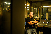 GUNTERSVILLE, AL – MAY 24, 2019: Newly elected sheriff Phil Sims surveys inmate activity from the corrections cube of the Marshall County Jail. Prior to vacating office, defeated incumbent J. Scott Walls emptied the coffers of the Marshall County Sheriff's Office, wiring tens of thousands of public dollars to himself and spending lavishly on unnecessary expenditures such as barrels of dish soap, 20,000 rolls of toilet paper and hundreds of boxes of garbage bags. When the excess supplies were discovered, most had to be sent back to suppliers, costing the new sheriff $2,500 in restocking fees. Sheriff Phil Sims, Wall's successor, now find themselves strapped for funds as they attempt to rehabilitate and repair an overcrowded jail system that has also suffered years of neglect. The incident in Marshall County is just one of many in the state of Alabama, where a trend among outgoing Sheriffs repeatedly leaves their replacements hamstrung for resources – and sometimes even unable to feed the inmates of the county jails they oversee.
