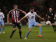 James Hanson of Sheffield United in action with Jordan Turnbull of Coventry City during the English League One match at the Bramall Lane Stadium, Sheffield. Picture date: April 5th, 2017. Pic credit should read: Jamie Tyerman/Sportimage