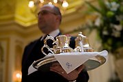 A waiter holds a tea service at the Hotel, London