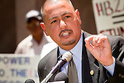 09 MAY 2011 - PHOENIX, AZ: State Senator STEVE GALLARDO, a Democrat, talks about his opposition to SB1070 and other anti-immigrant laws at the Arizona State Capitol in Phoenix Monday. Governor Jan Brewer, State Senate President Russell Pearce and Attorney General Tom Horne, all Republicans, held one press conference to announce that the state was suing to take its legal battle over SB1070, Arizona's tough anti-immigration law, past the US Court of Appeals and straight to the US Supreme Court. State Senator Steve Gallardo, a Democrat, held a press conference to announce that he was opposed to the Republican's legal actions and called on them to drop the suit altogether. Isolated shouting matches broke out between activists on both sides of the immigration issue during the press conferences.       Photo by Jack Kurtz