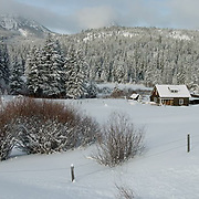 Little Lodge house near Bridger Mountains. Snow scenic. Montana. Winter.